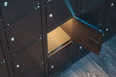 Safe deposit boxes with switched-on light. Safety closets. 3d rendering. Black safe deposit boxes with switched-on light. Safety closets. 3d rendering. one safe royalty free stock photos