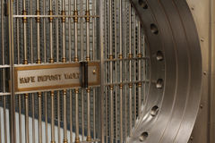 Safe Deposit Vault. A bank's large safe deposit box vault gated shut Stock Photo
