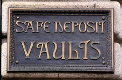 Safe Deposit Vaults Sign. A historic heavy brass sign announcing safe deposit vaults at a former bank Stock Images