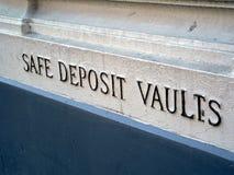 Safe Deposit Vaults sign on bank. A stone background for safe deposit vaults sign stock photos