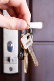 Safe door. Key in a keyhole Royalty Free Stock Photography