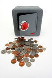 Safe with door open. Safe with red combination dial and lots of coins and door open Stock Photo