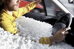 Safe Driving. A Man Driving His Car Immersed In Polystyrene: Thiat's Security royalty free stock images