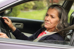 Safe driving mature woman Royalty Free Stock Photography