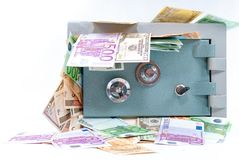 Safe with money. Safe full of money coming out stock images