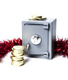 Safe, golden coins and christmas decoration Royalty Free Stock Photography