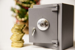 Safe, golden coins and christmas tree Royalty Free Stock Images