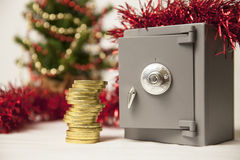 Safe, golden coins and christmas tree Stock Photos