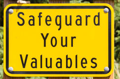 Safe guard valuables sign. Sign to warn of safeguarding valuables in public area Royalty Free Stock Photography