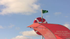 Safe guarded beach life guard green flag stock video footage