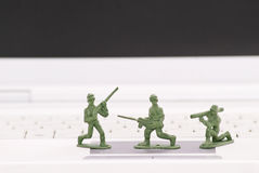 Safe Guarding Your PC. With Armed Army Men Stock Photos