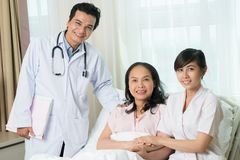 In safe hands!. Portrait of doctors and a nurse in the hospital chamber Royalty Free Stock Photo