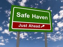 Safe haven sign. Safe haven just ahead road sign with directional arrow, blue sky and cloudscape background royalty free stock photography