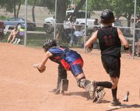 Safe at Home. A runner getting home safely in a fastball game Royalty Free Stock Photography