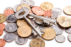 Safe key with coins Royalty Free Stock Photo
