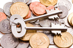 Safe key with coins Royalty Free Stock Photography