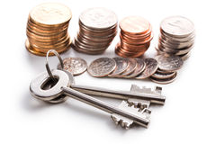 Safe key with coins Stock Photo