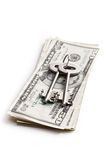 Safe key with money. The safe key with money Stock Photos