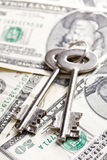Safe key with money. The safe key with money Royalty Free Stock Images