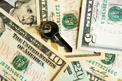 Safe key with money. The safe key with money Stock Photography