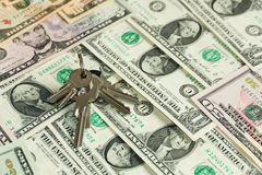 Safe key with money Stock Photography