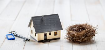 Safe key, sustainable home and comfortable nest for green investment Stock Photos