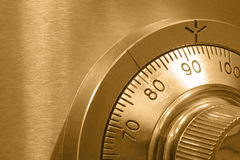 Safe Lock in Gold. Closeup of combination safe lock, with golden tone Stock Images