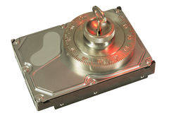Safe lock secures hard disc in red Stock Images