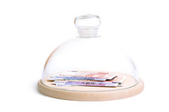 Safe money. 500, 200, 100, 50, 20 and 10 Euro banknotes under bell jar over white background - financial security concept Stock Image