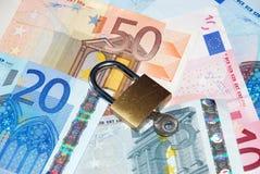 Safe Money. Metaphor to safe money with eur bills Royalty Free Stock Image