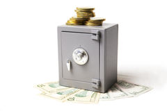 Safe, money and coins Royalty Free Stock Photo