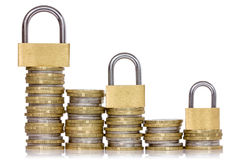 Safe money. Coins and padlocks isolated on a white background Royalty Free Stock Image