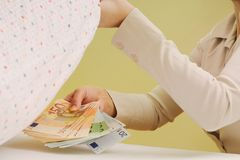 Safe money - hiding money under pillow Royalty Free Stock Photography