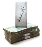 Safe on money. Lock box safe on pile of money in wrapper Royalty Free Stock Photo