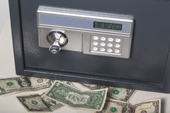 Safe with money. Locked Safe with money near it Stock Photos