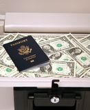 Safe Money and Passport. Home safe with money and US passport inside Stock Image
