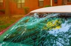 Broken car window an accident on the road safe movement. Safe movement broken car window, an accident on the road glass windshield crash shattered wreck royalty free stock photos