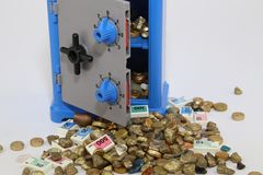 Safe. An open safe from gold and money falls Royalty Free Stock Photography