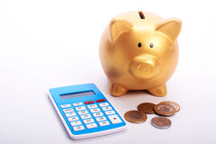 Safe piggy with calculator and coins from Brazil Stock Photography
