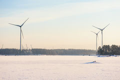 Safe renewable wind energy generators. Finland, Kotka. Landscape with frozen sea shore Stock Images