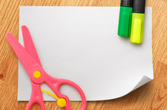 Safe scissors and markers on blank white paper Stock Images