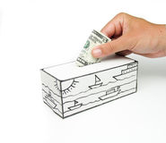 Safe with sea and five dollars being deposited. Vault paper drawing of a sea with boats and a five-dollar bill being filed by one hand Royalty Free Stock Photo