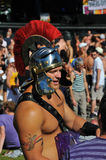 Safe sex. The Trojan representative (dressed up as a gladiator) distributes free condoms at an afternoon rave ... Divers Cite: Gay summer festival in Montreal Royalty Free Stock Photo