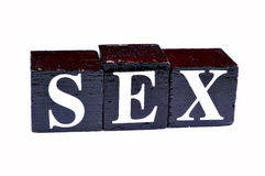 Safe sex. Sex written on the black cubes royalty free stock photo