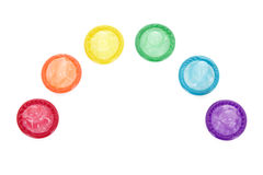 Safe sex rainbow. A rainbow of coloured condoms, isolated on a white background stock photography