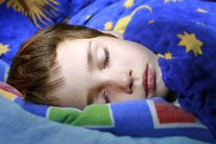 Safe sleep. Boy sweetly dreaming in his bed, safe sleep Stock Photos