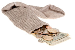 Safe sock. Dollar banknotes and coins in an old grey sock stock photo