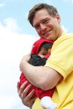 Safe and Sound in Dad's arms Royalty Free Stock Photo