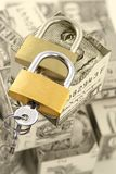 Safe storage of money. Concept strengthening safety of savings-locks on a background of cash Royalty Free Stock Photo