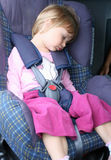 Safe trip. Young girl rests in the car seat Royalty Free Stock Photography
